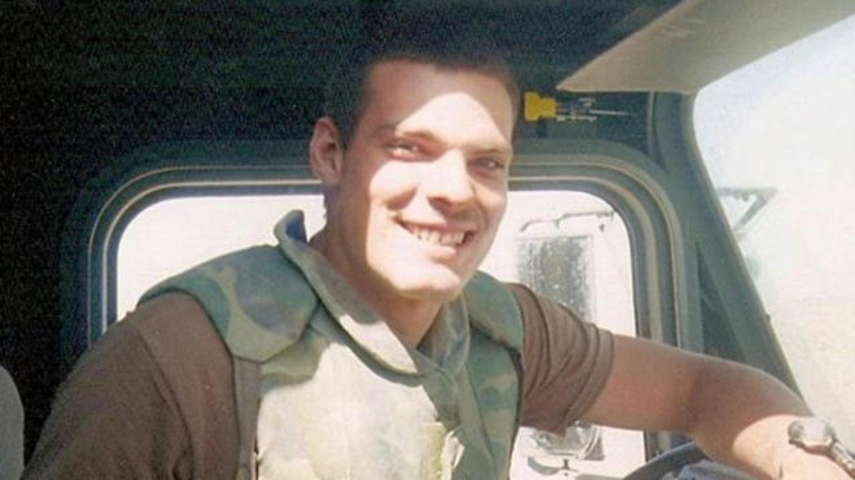 Justin Huff smiling while in khaki uniform