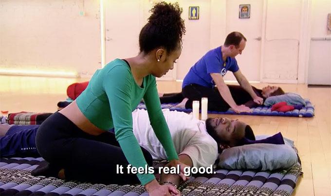 MAFS Season 11 couple Karen massaging Miles who is laying on the ground.