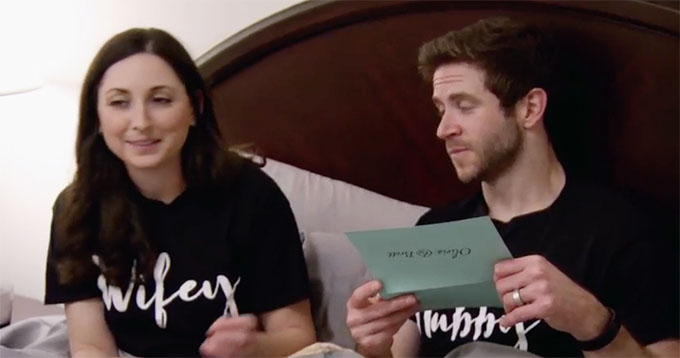 MAFS Season 11 couple Olivia and Brett reading a question card in bed