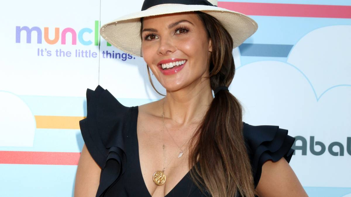 Ali Landry poses on the red carpet