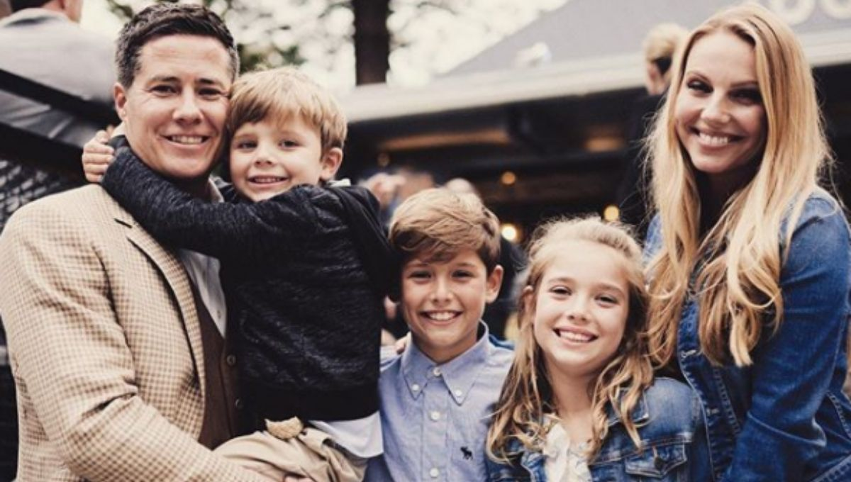 Andrew Firestone posing with his wife Ivana and their three children wearing nice outfits