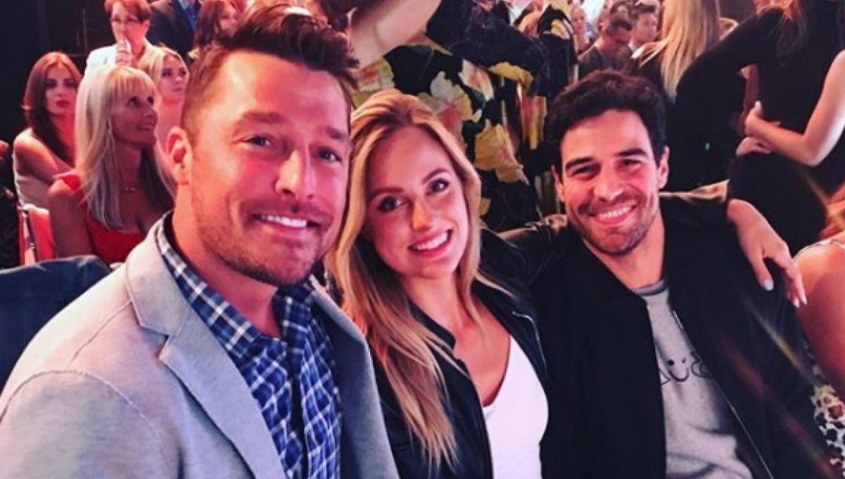Chris Soules poses in a theater with previous Bachelor contestants grocery store Joe and Kendall Long