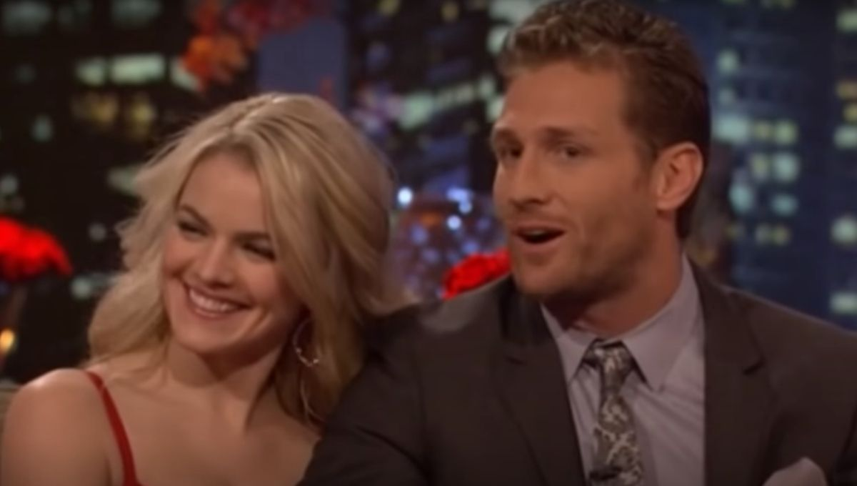 Nikki Ferrell smiles in a red dress next to Juan Pablo on a couch