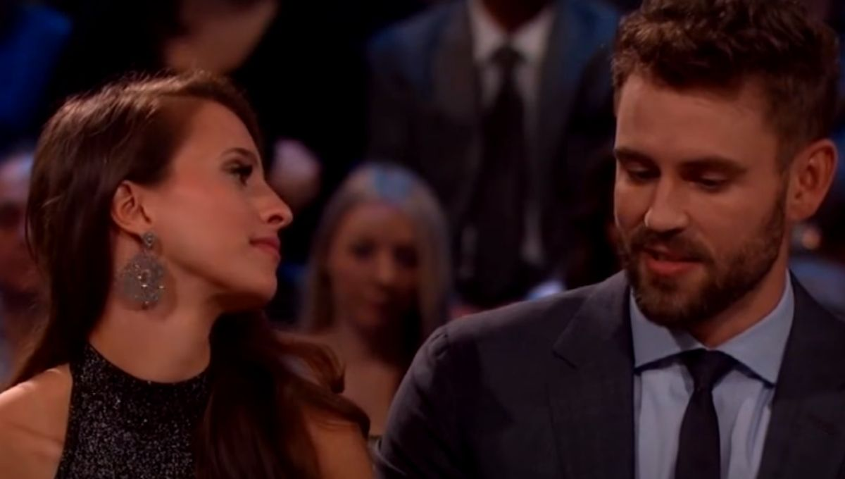 Vanessa Grimaldi looks at Nick Viall as he talks while they sit on a couch