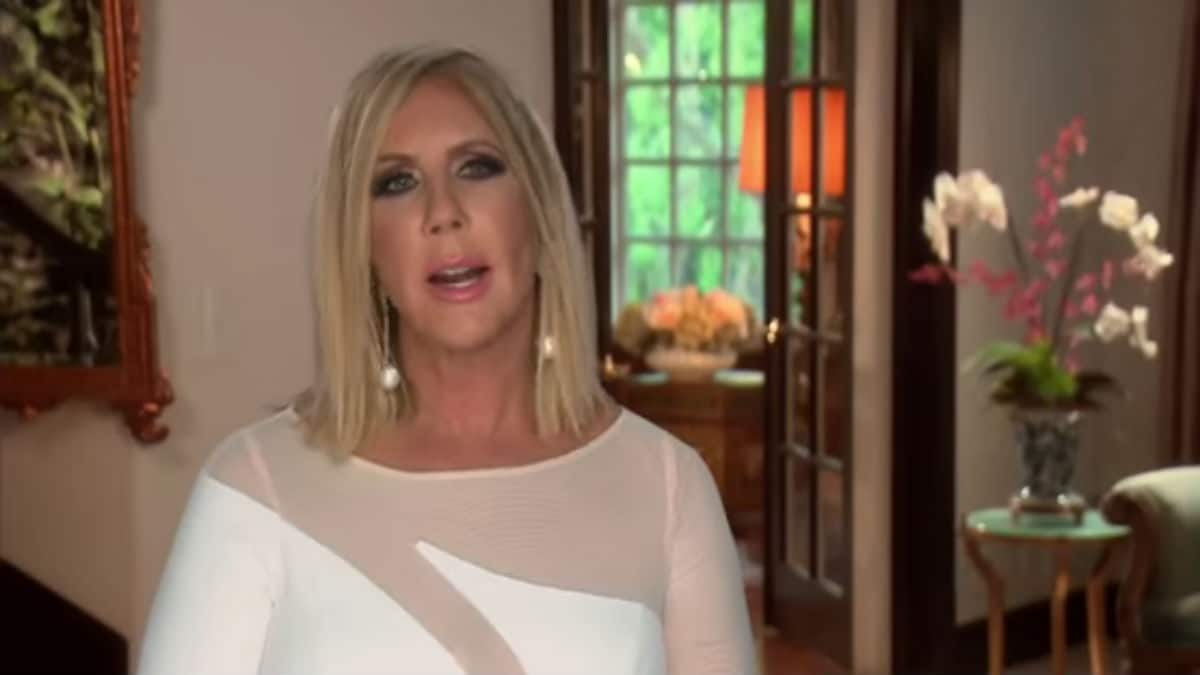 Vicki Gunvalson sits in a confessional for RHOC