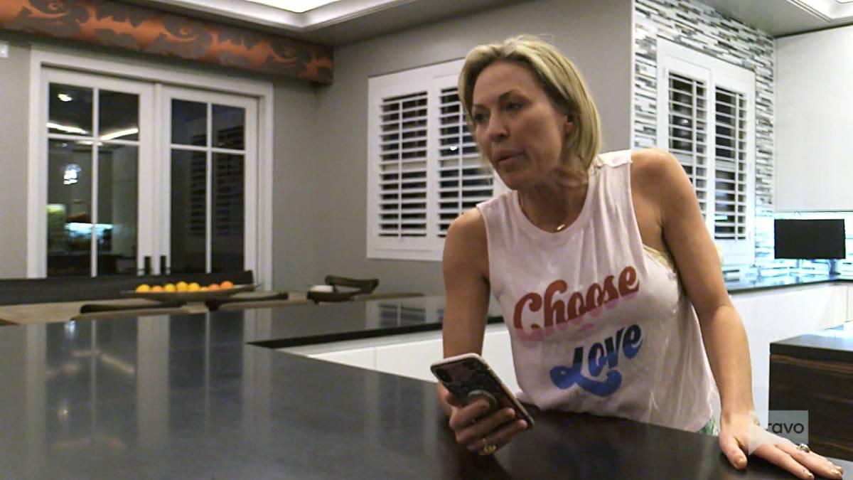 Braunwyn Windham-Burke speaks on the phone with Gina Kirschenheiter