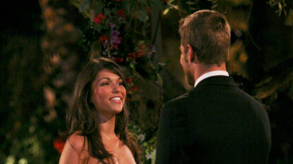 DeAnna Pappa talks to a contestant in front of the Bachelor mansion.