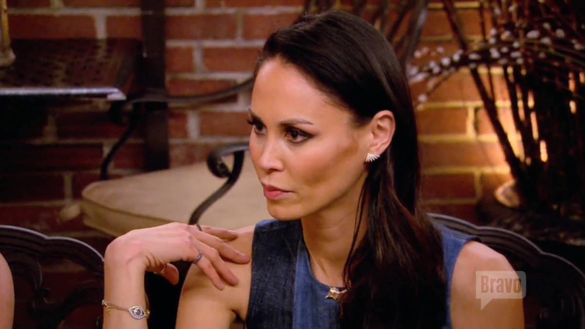 Jules Wainstein puts her hand on her shoulder.