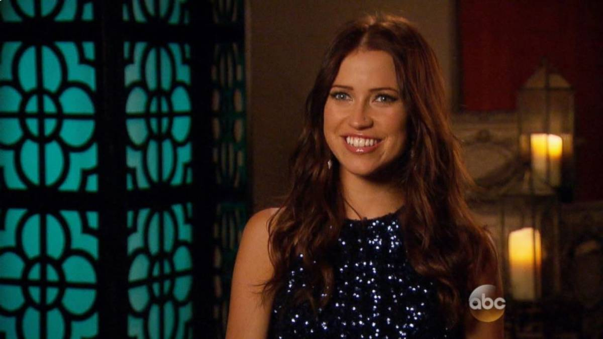 Kaitlyn Bristowe sits in the confessional wearing a blue sequin dress.