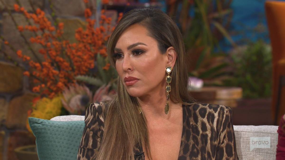 Kelly Dodd looks to the left of the camera while filming the reunion.