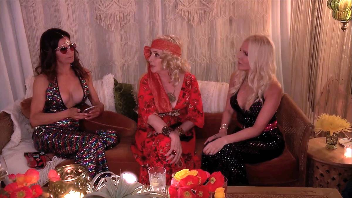 Shannon Beador talks to her friends at a 70's party.