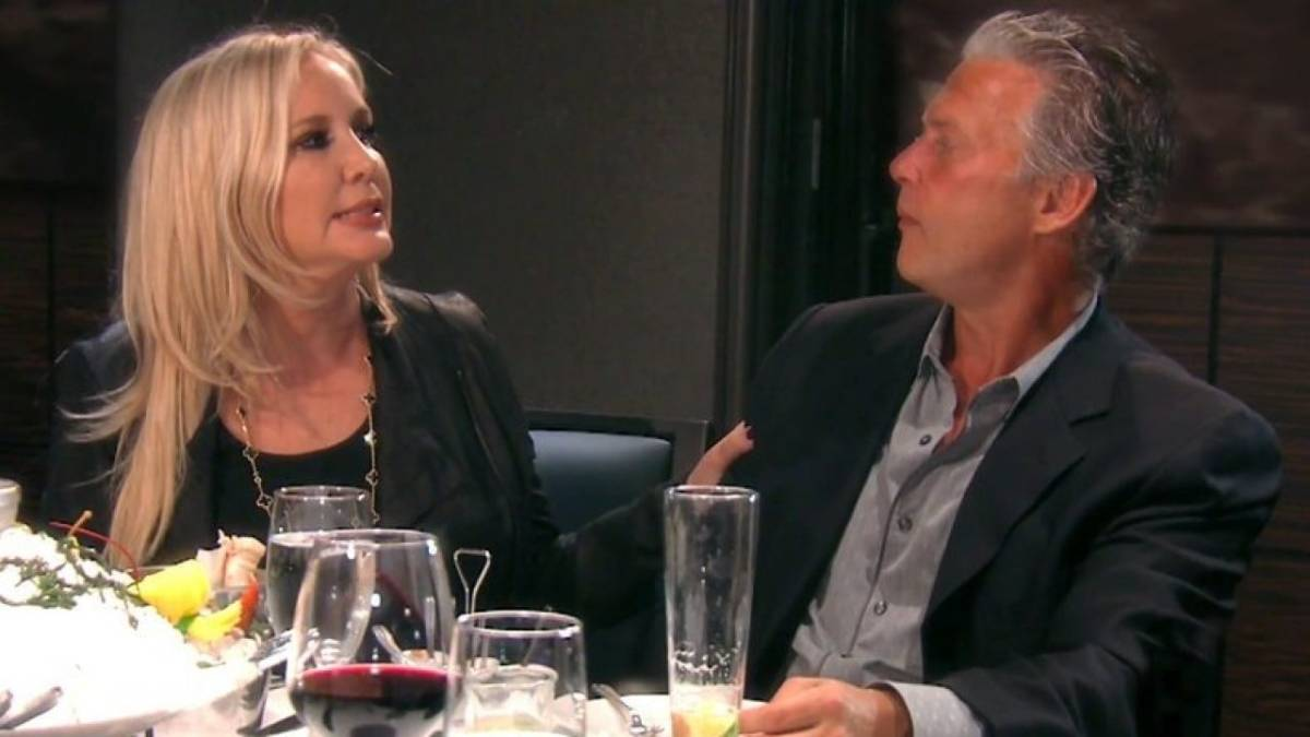 Shannon Beador (left) touches David Beador's (right) arm during dinner.