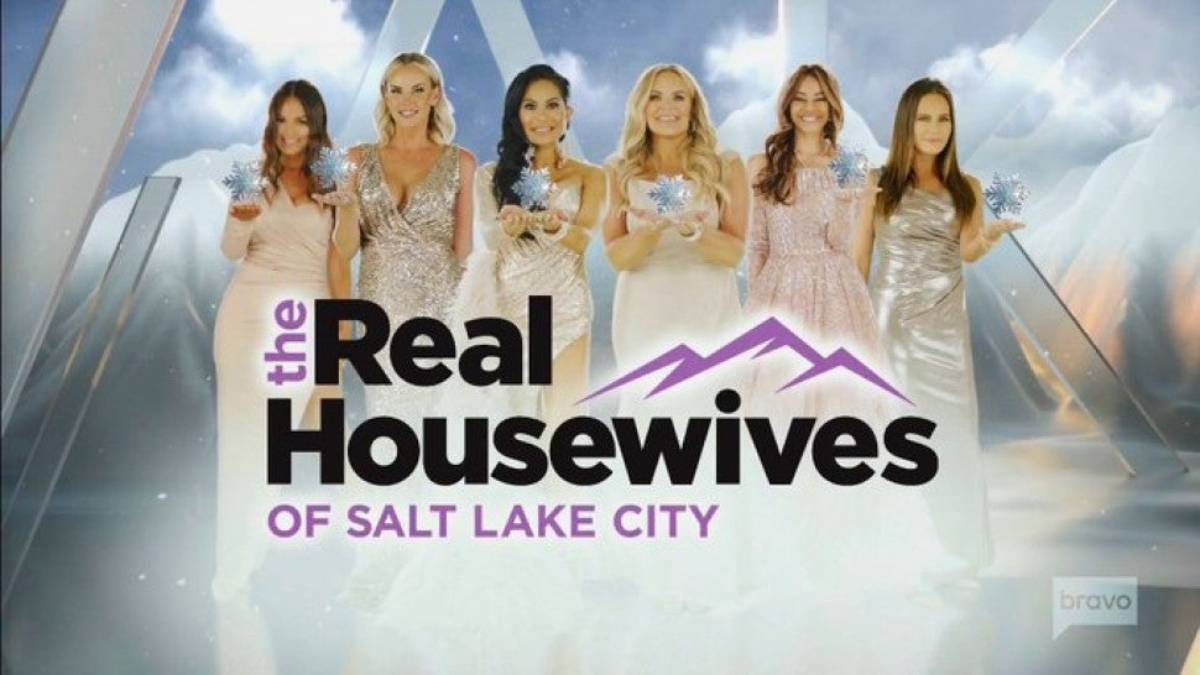 The cast of Real Housewives of Salt Lake City pose holding snowflakes.
