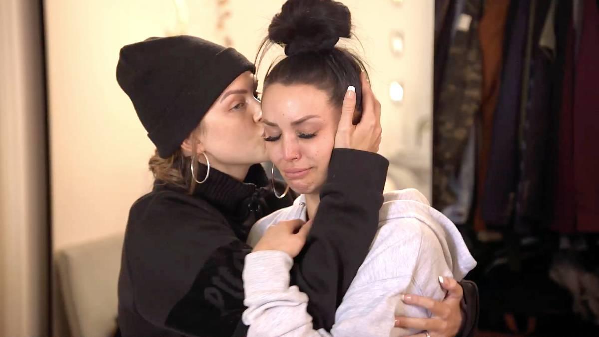 Lala Kent hugs and kisses Scheana Shay's cheek.