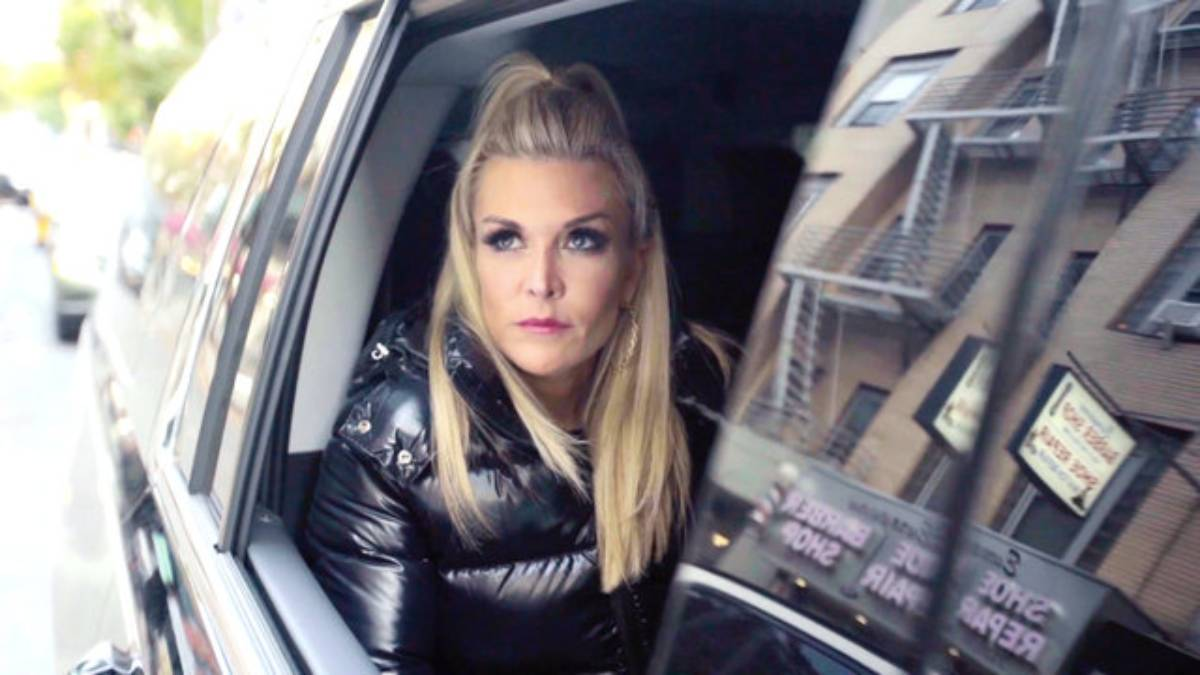 Tinsley Mortimer looks out of the window of a black car.