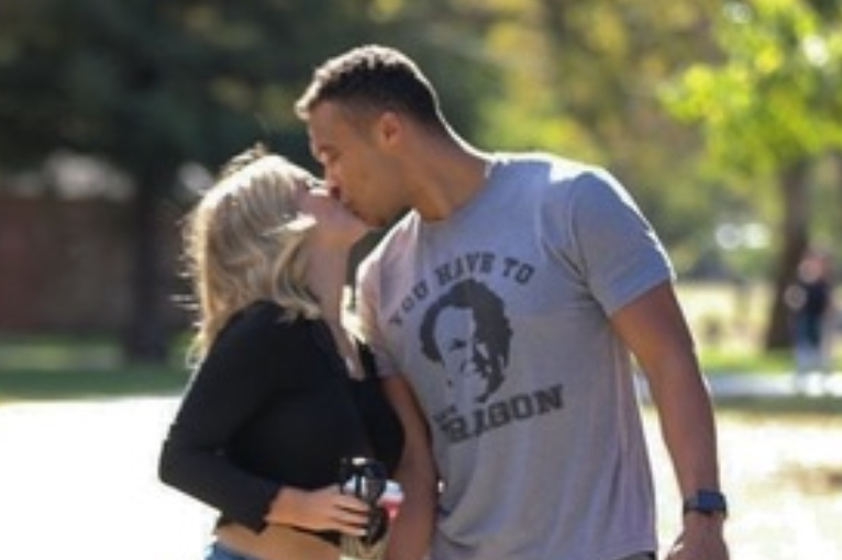 Clare Crawley and Dale Moss share a kiss while on a walk through McKinley Park in Sacramento