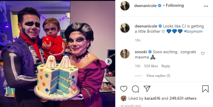 Deena Cortese posing with husband Chris Buckner and their son CJ for a Halloween themed gender reveal