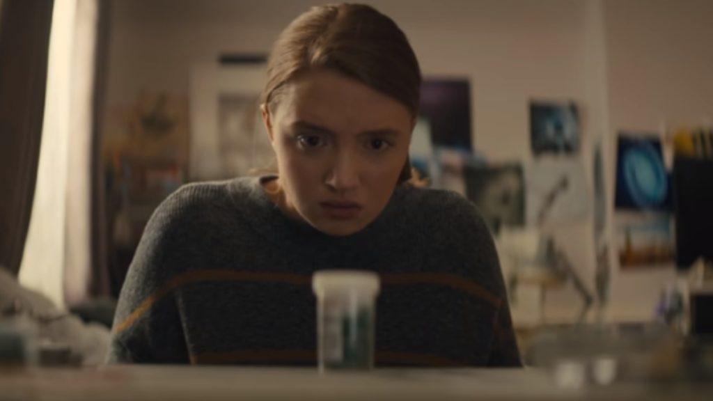 Kiera Allen suspiciously eyes a bottle of Trigoxin
