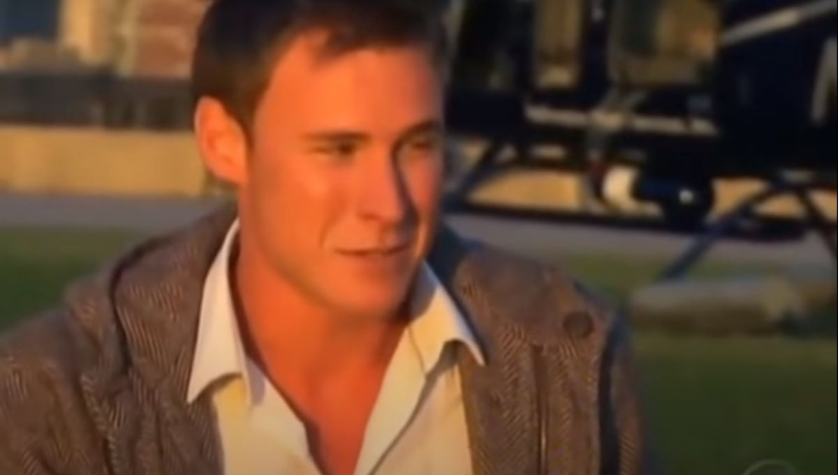 Kasey Kahl in a white shirt and tan jacket