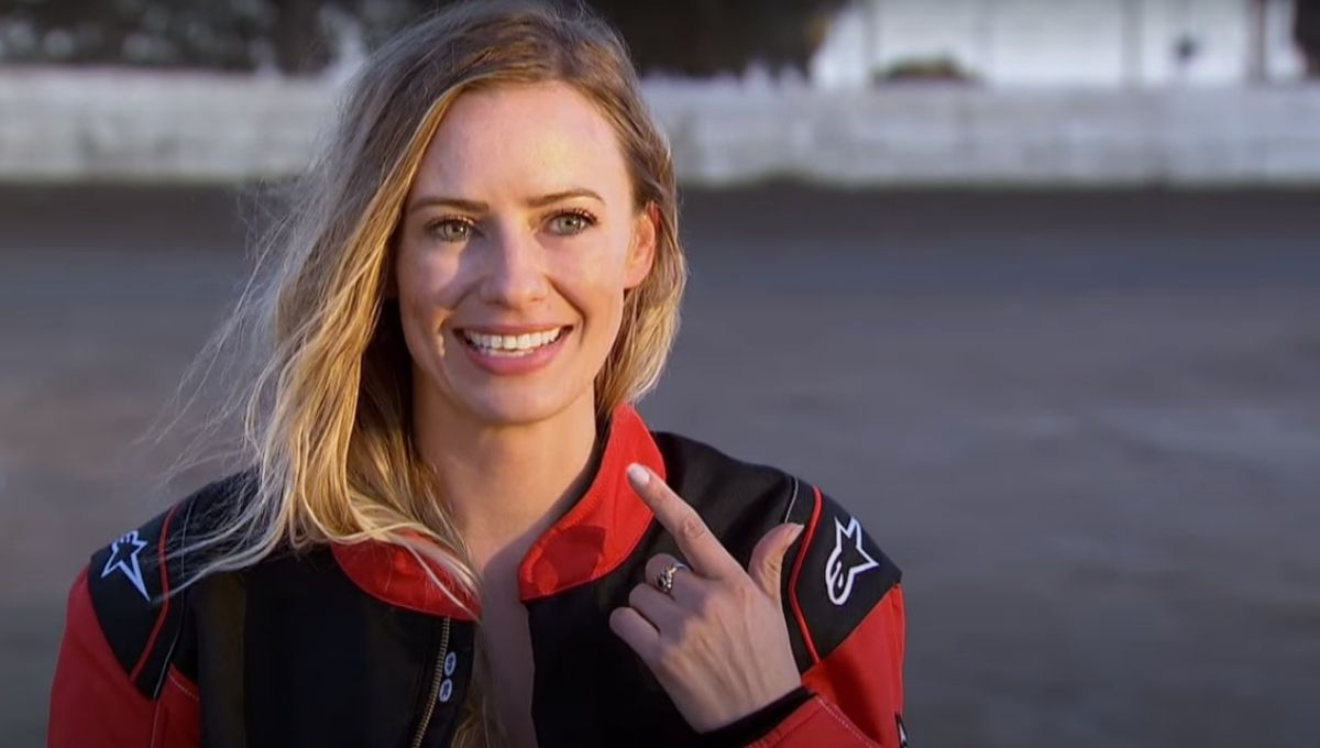 Annaliese Puccini smiles while wearing a racing jacket
