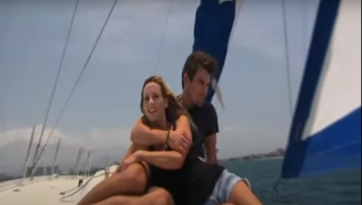 Clare Crawley sits in front of Jared Haibon on a sail boat in the water