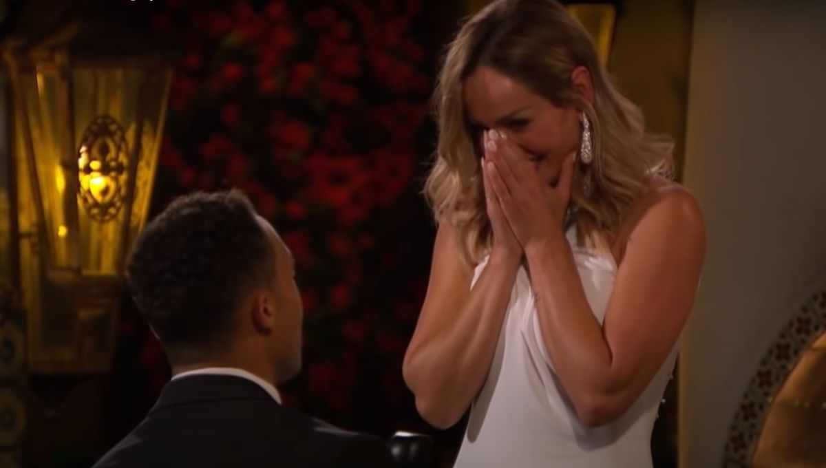 Dale Moss proposes to Clare Crawley as she stands over him in a white dress with her hands over her mouth