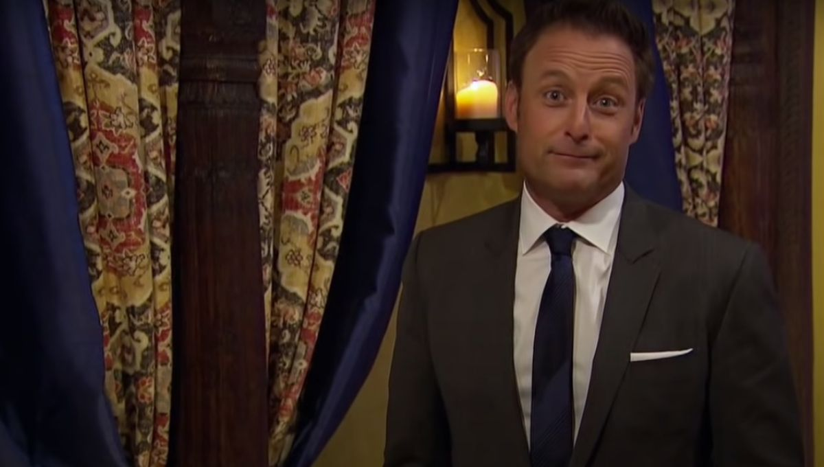 Chris Harrison in a suit making a face at the camera