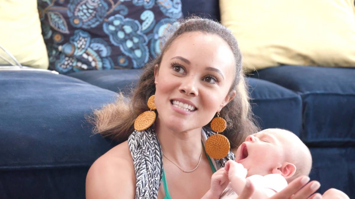 Ashley Darby holds her son Dean while filming for RHOP.
