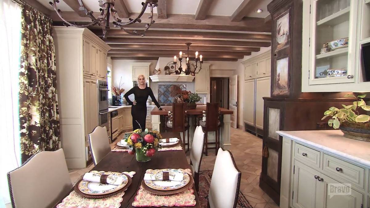 Erika Jayne poses in the mansion she shared with ex-husband Tom Girardi.