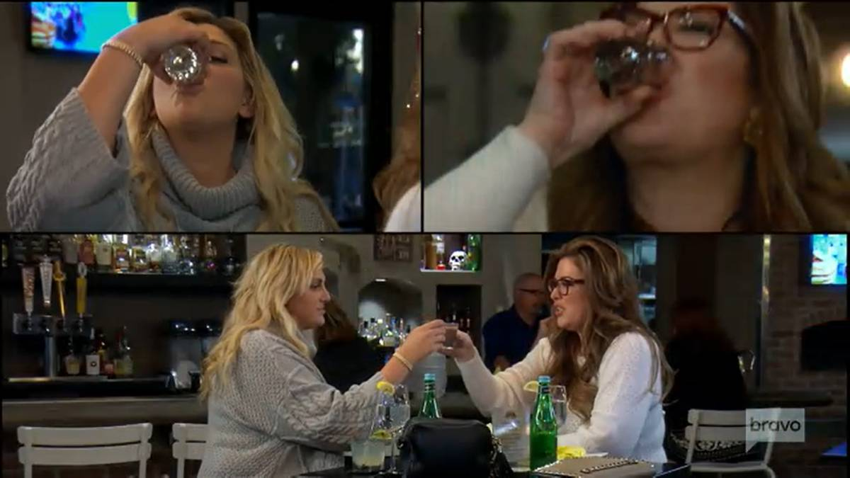 Gina Kirschenheiter and Emily Simpson drink at dinner while filming RHOC.
