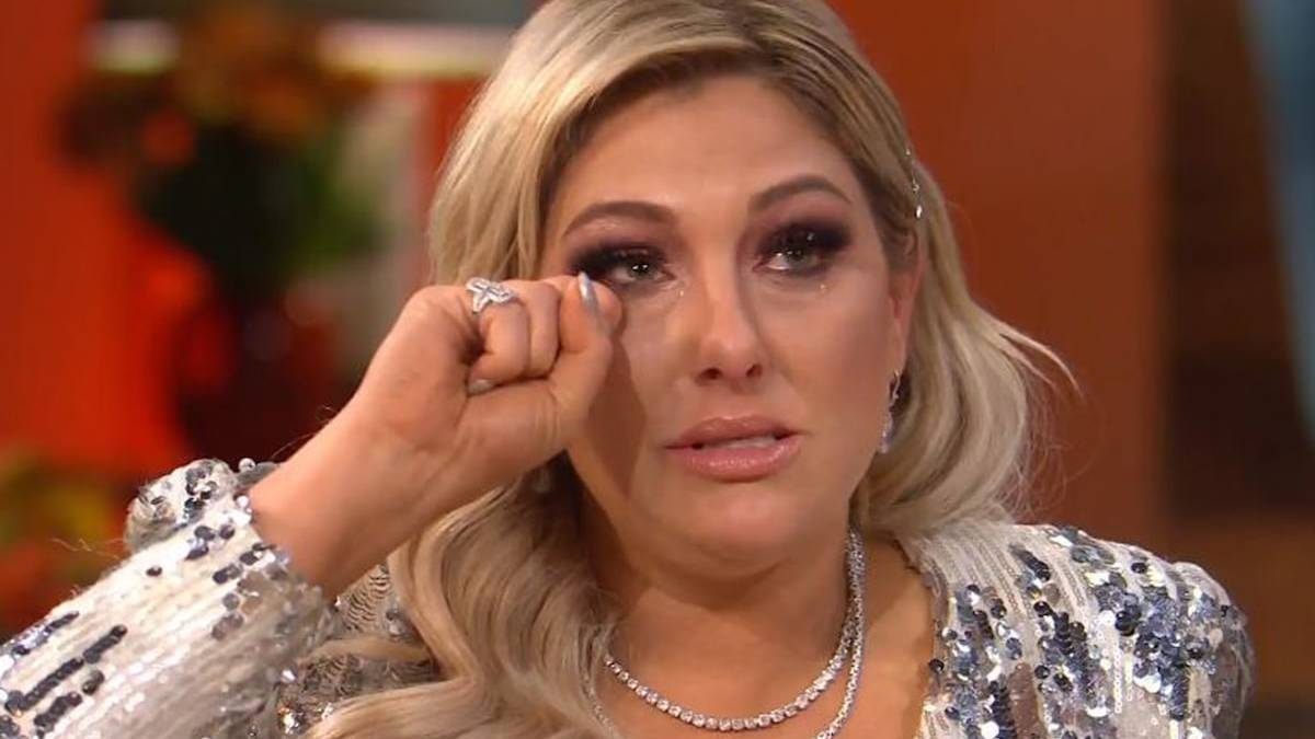 Gina Kirschenheiter wipes her eyes during RHOC Season 14 reunion.