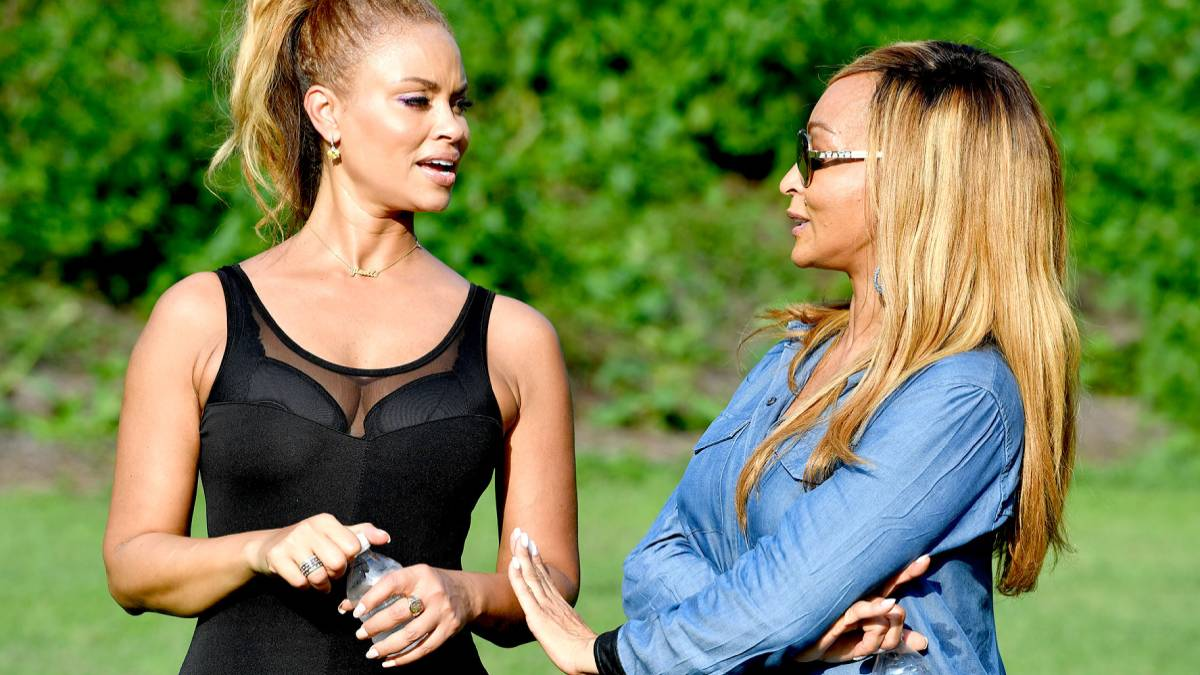 Gizelle Bryant and Karen Huger talk while filming RHOP.