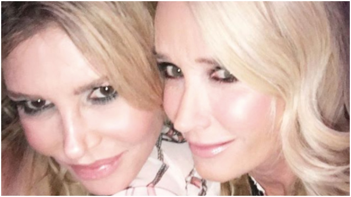 Former RHOBH stars Brandi Glanville and Kim Richards smile for a picture.