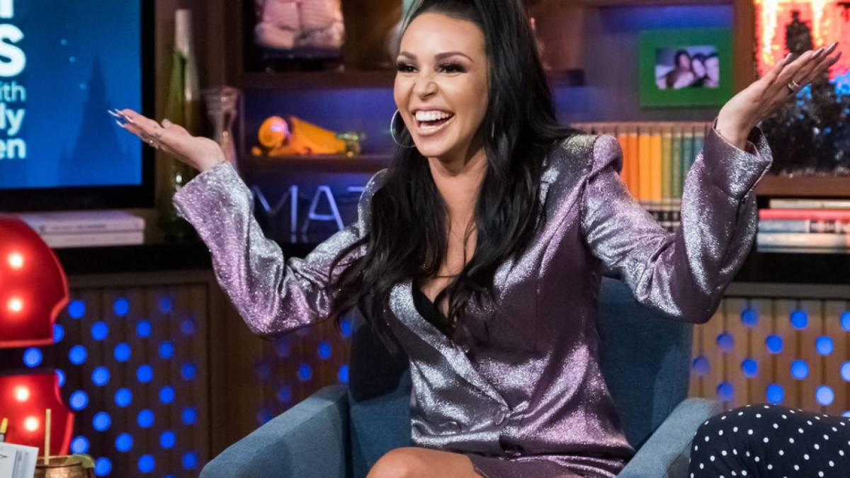 Scheana Shay holds her arms up on Watch What Happens Live.