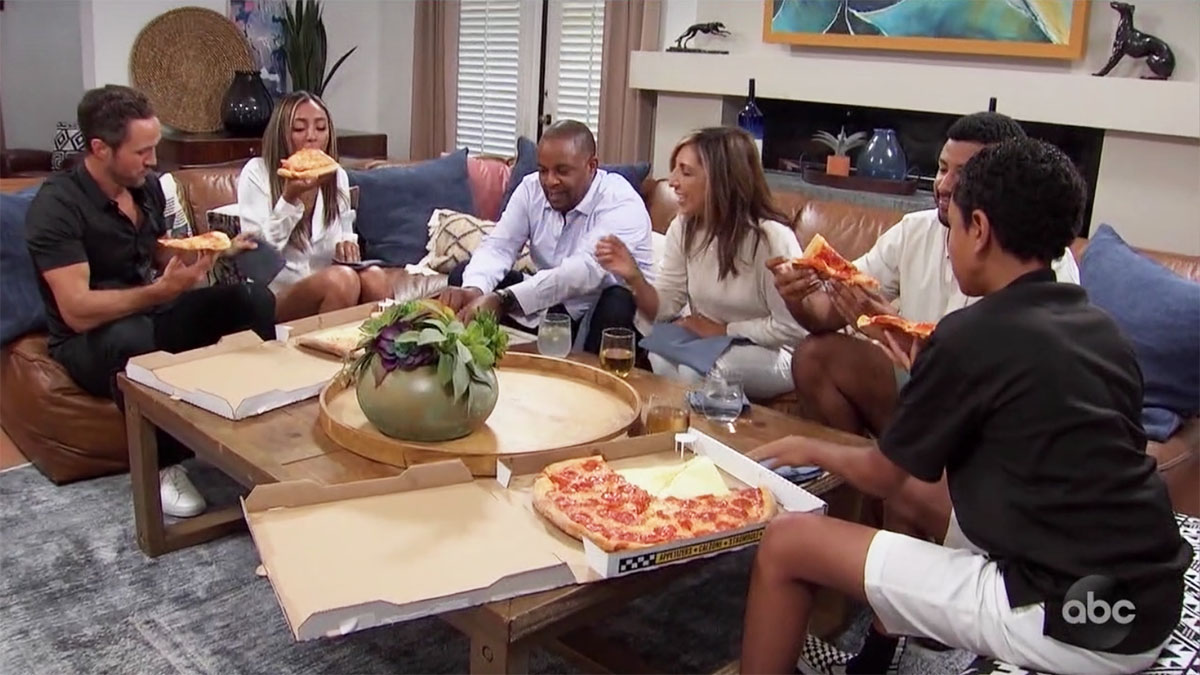 Bachelorette Tayshia and family eating New York pizza with her Zac Clark