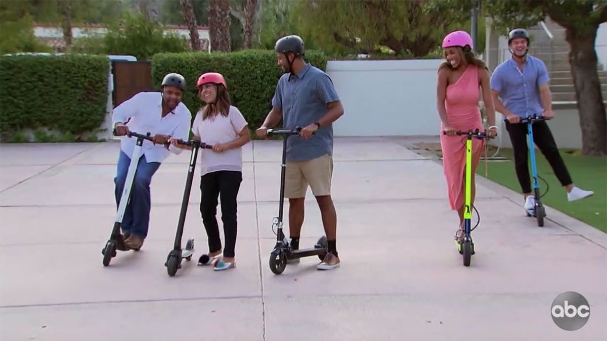 Bachelorette Tayshia Adams and family riding scooters with Ben
