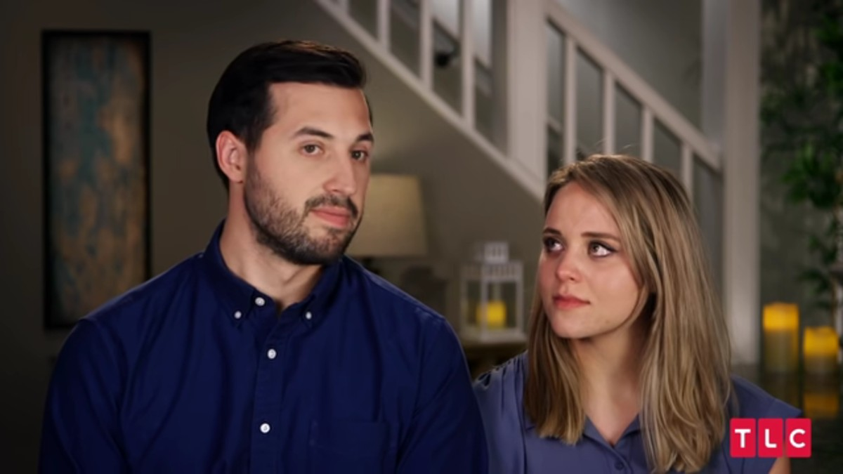 Jinger and Jeremy in a Counting On confessional.