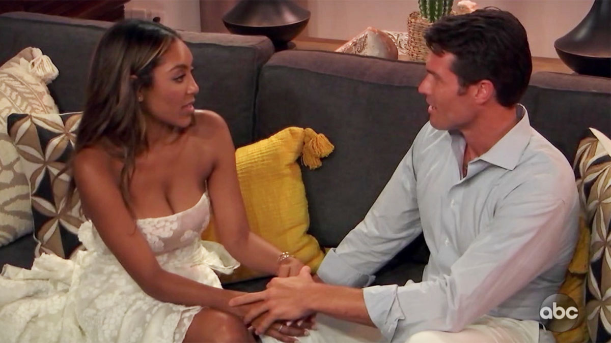 The Bachelorette Tayshia Adams holding Bennett's hands