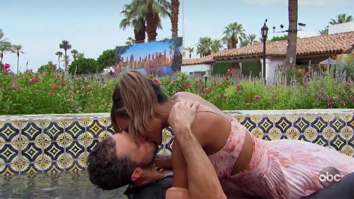 Bachelorette Tayshia Adams kissing Zac C. in water fountain