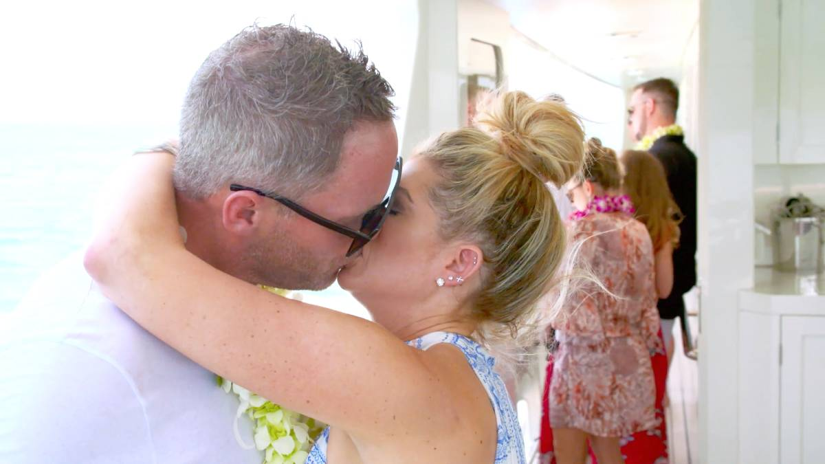 Alexis Bellino and Andy Bohn kiss while filming for Below Deck.
