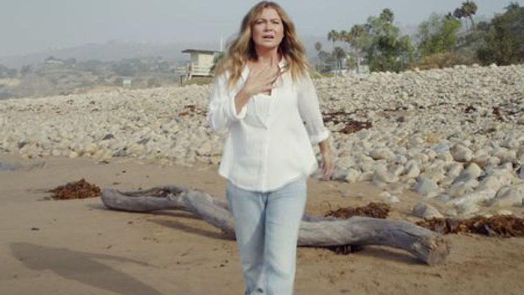 Meredith runs on the beach