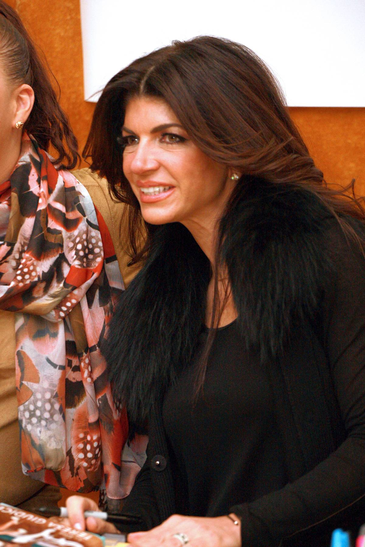 Teresa Giudice at a book signing for her memoir Turning the Tables: From Housewife to Inmate and Back Again.
