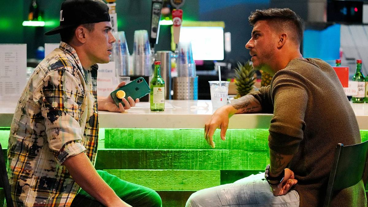 Tom Sandoval and Jax Taylor talk while filming Vanderpump Rules.