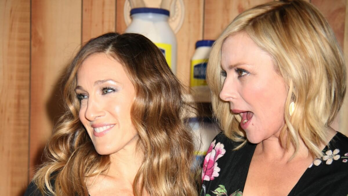 Kim Cattrall and Sarah Jessica Parker attending a movie premiere