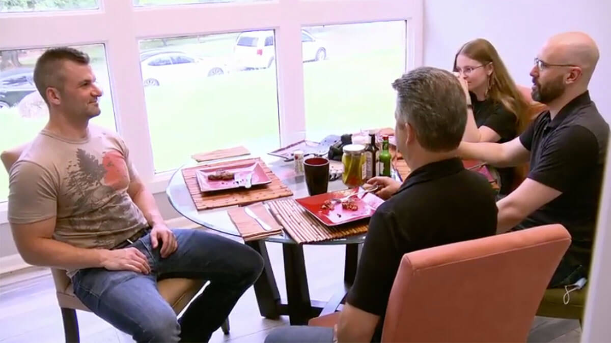 MAFS Season 12 Jacob sitting at kitchen table eating steaks with family
