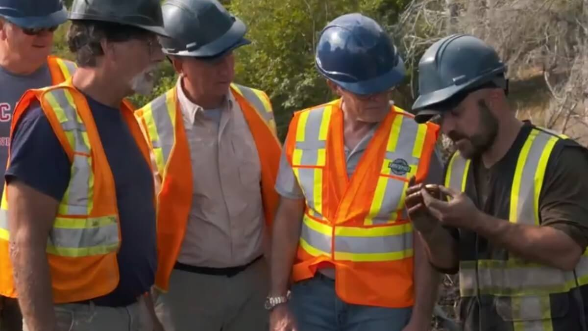 Oak Island guys examine a piece of treasure