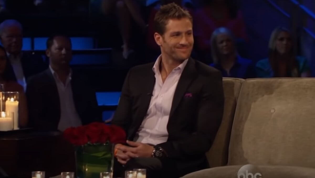 Juan Pablo in a suit sitting on the couch during The Women Tell All