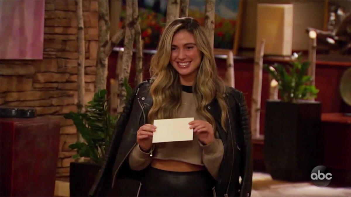 Bachelor contestant reads off group date card