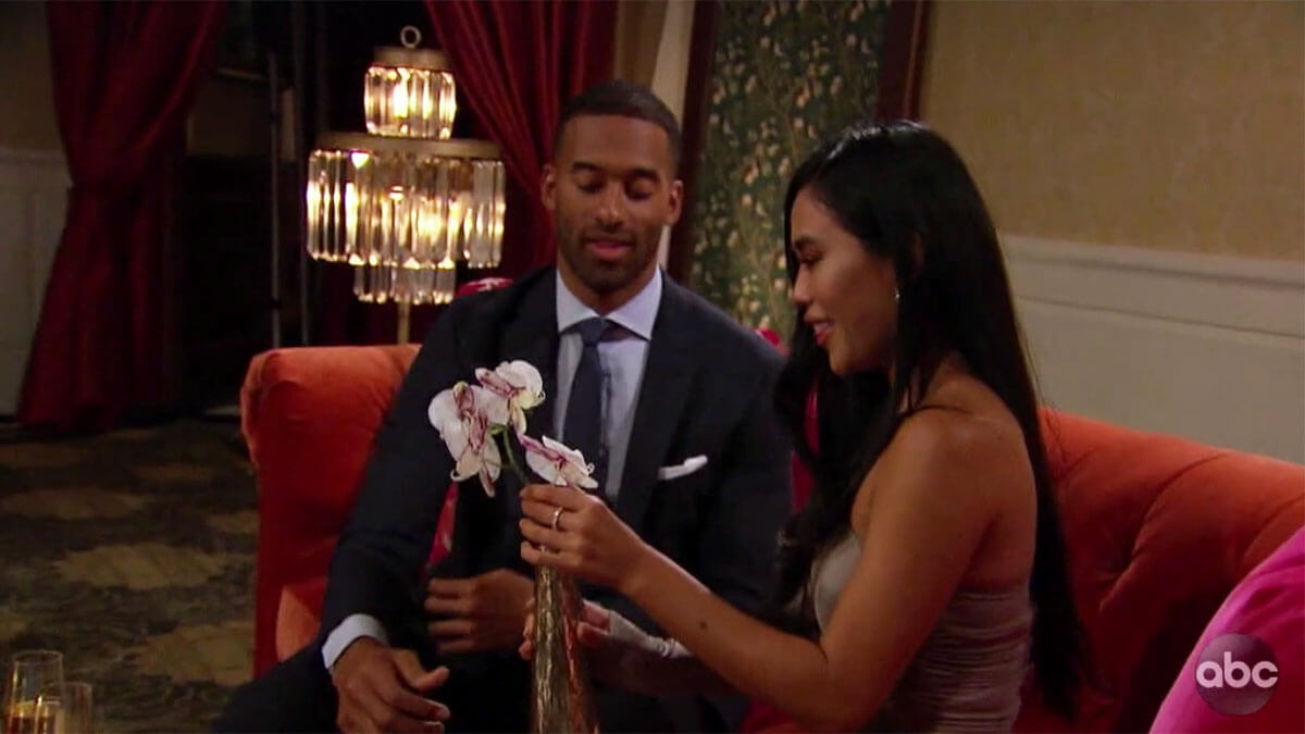 The Bachelor Matt James giving an orchid to contestant