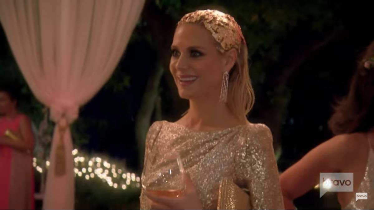 Dorit Kemsley films for RHOBH at a party.